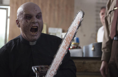 Nick Hood as Reverend Chainsaw - Frankenstein Created Bikers